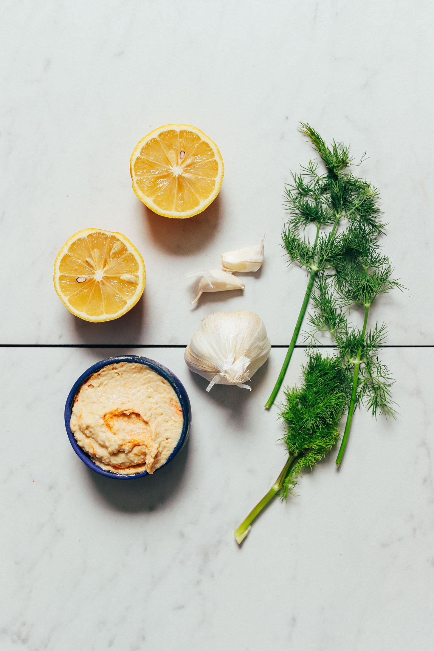 Hummus, garlic, fresh dill, and lemon for making our simple Hummus Garlic Sauce recipe