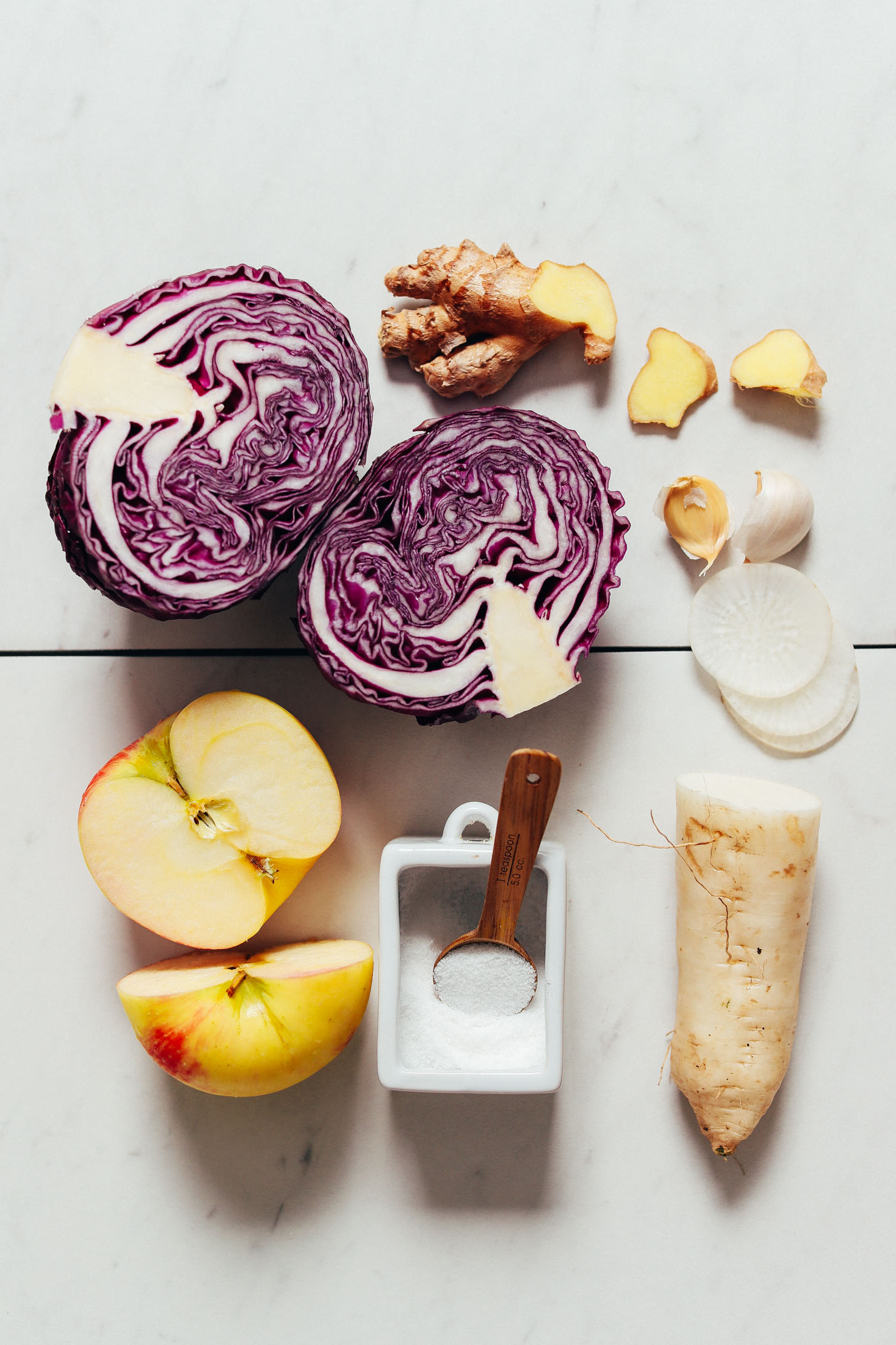 Daikon, red cabbage, apple, salt, ginger, and garlic for making our Apple-Cabbage Sauerkraut recipe