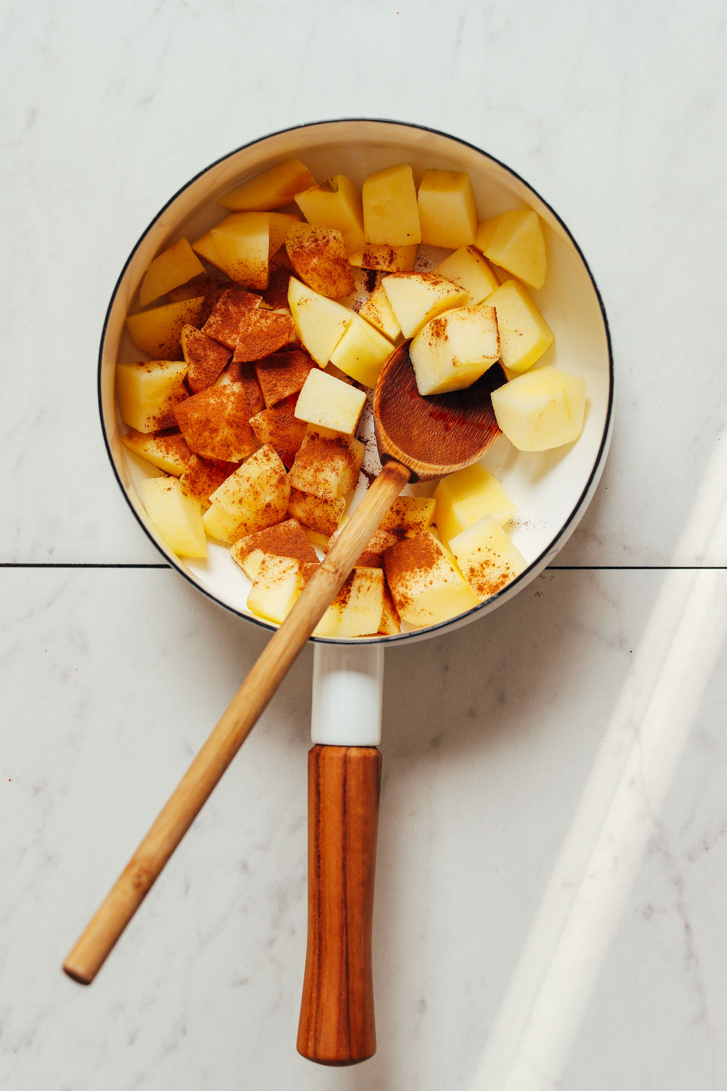Diced apples and cinnamon in a saucepan for making our simple homemade applesauce recipe
