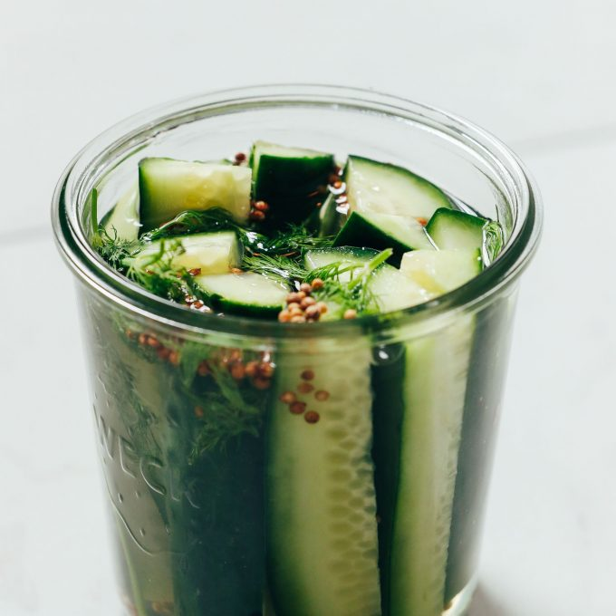 Jar of refrigerator pickles made with dill and spices