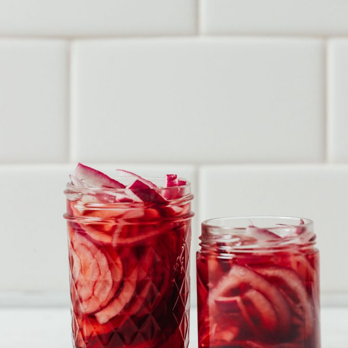 Two small jars of our Quick Pickled Onions recipe