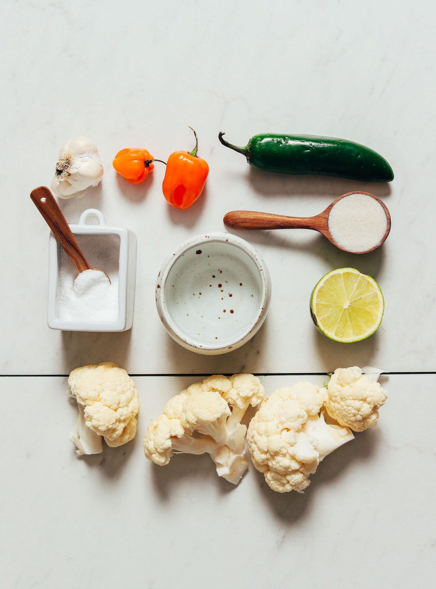 Cauliflower, habanero, jalapeno, lime, and other ingredients for making our easy Escabeche recipe