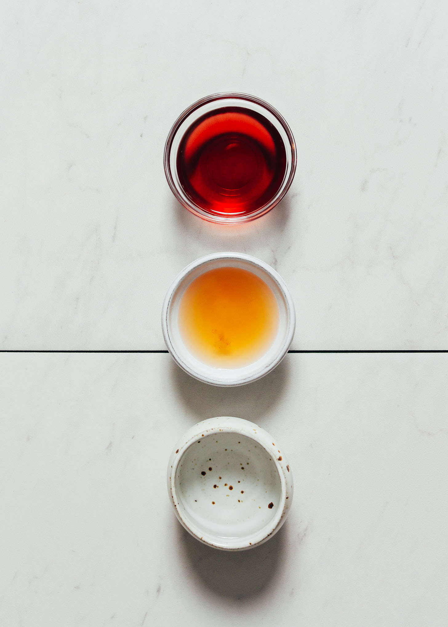 Three bowls of different types of vinegars for making Quick Pickled Vegetables