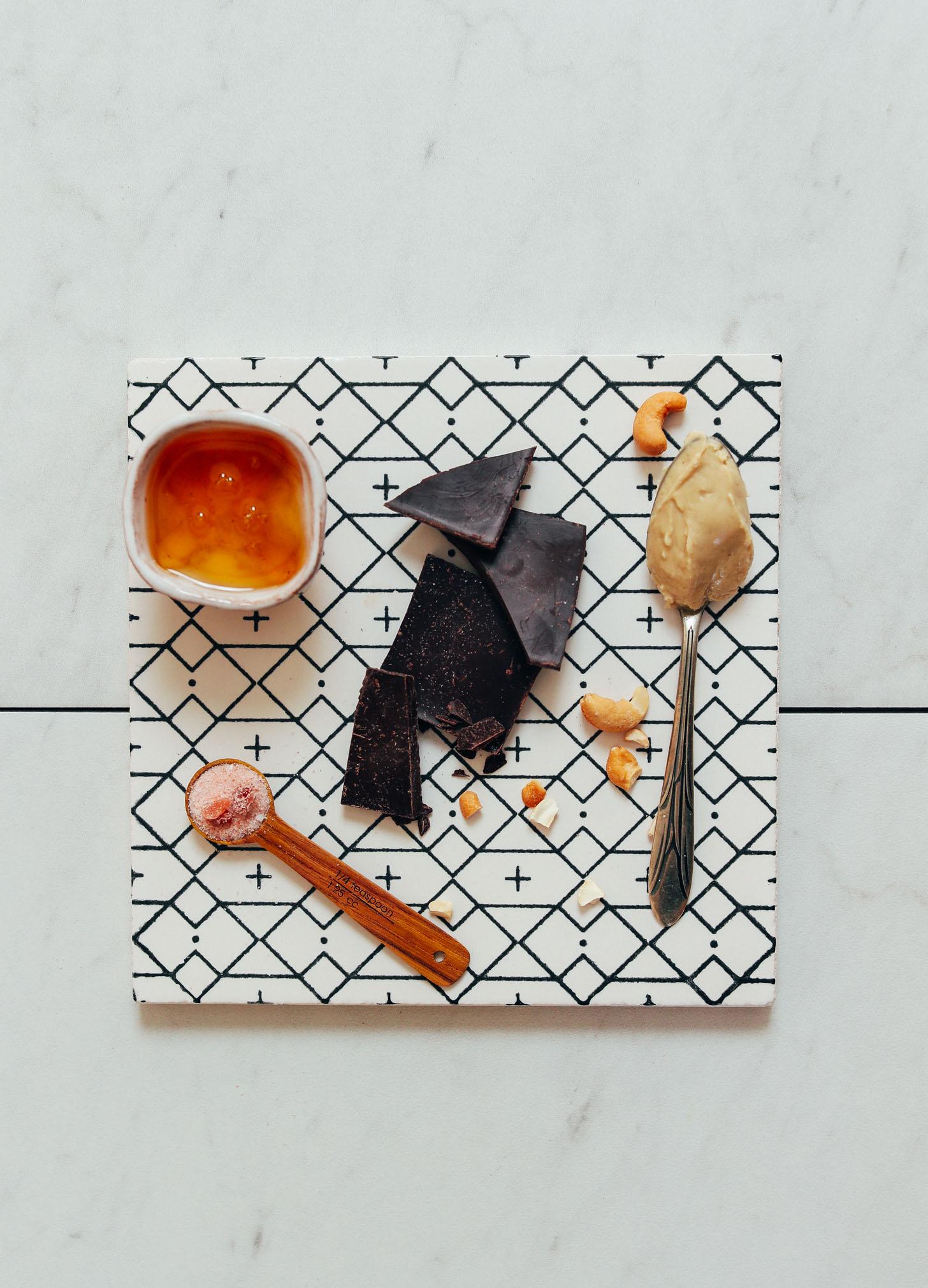 Honey, salt, dark chocolate, and cashew butter for making honey-sweetened Chocolate Fudge