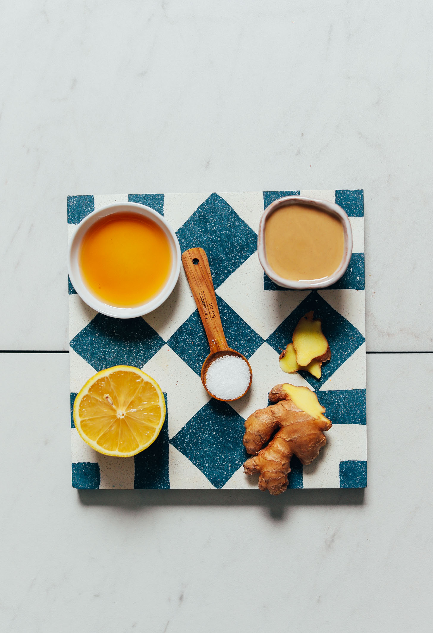 Maple syrup, tahini, lemon, salt, and ginger for making our easy Lemon Tahini Sauce recipe