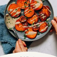 Plate of sweet potatoes drizzled with tahini with text saying 8-Minute Sweet Potatoes
