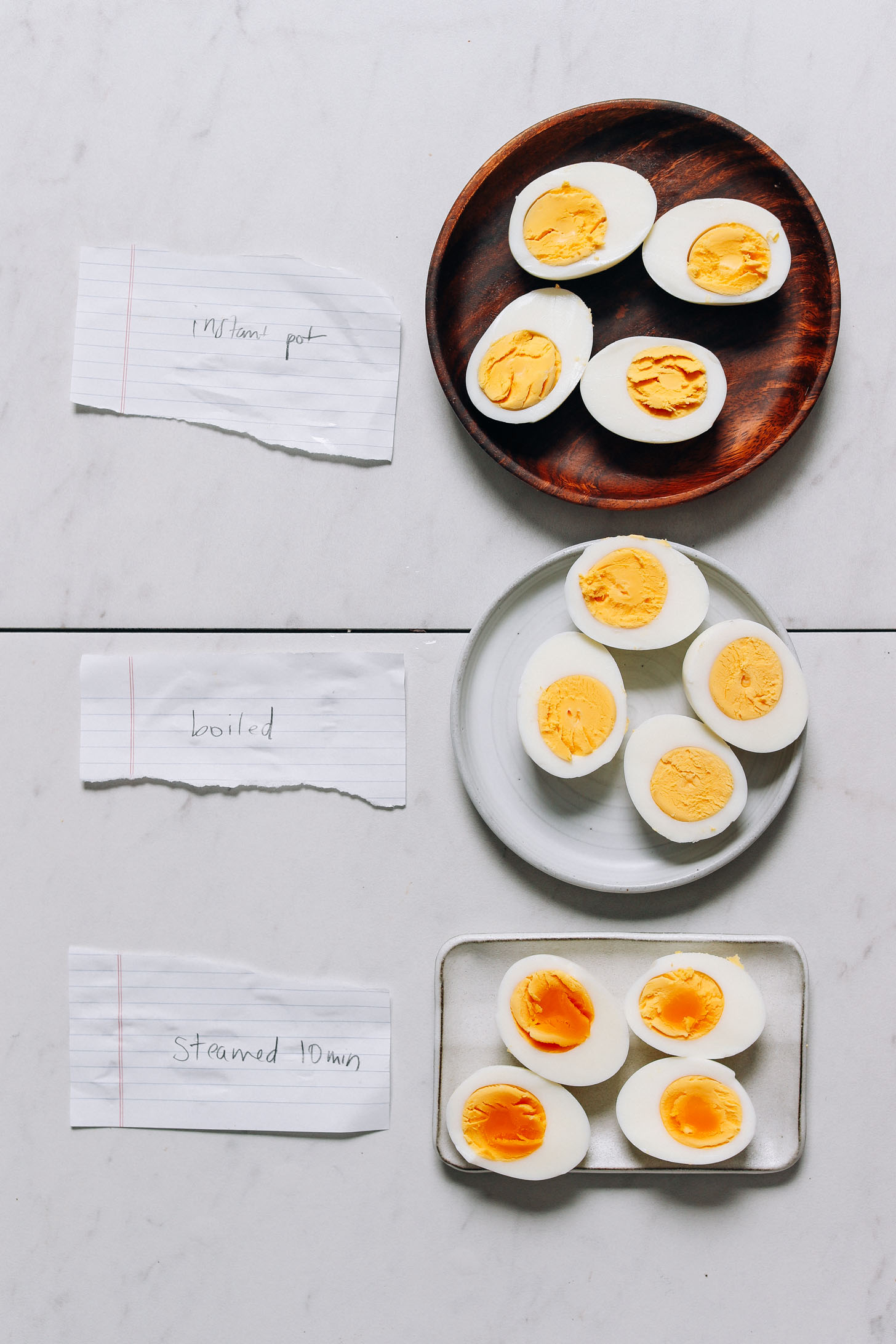 Three plates of perfectly cooked hard boiled eggs made three ways