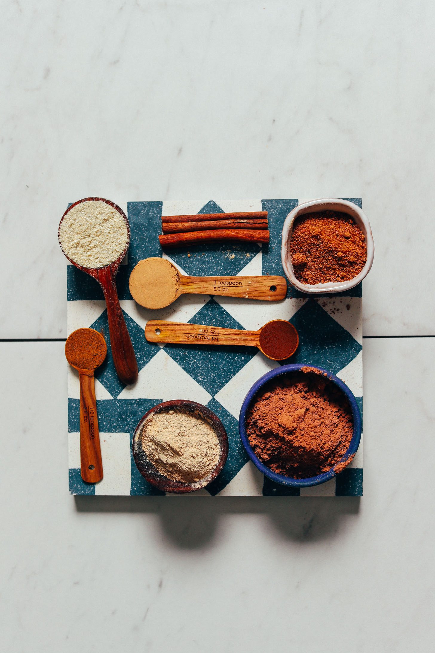 Cacao powder, maca, tocos, and other superfoods for making our Adaptogenic Hot Chocolate Mix recipe