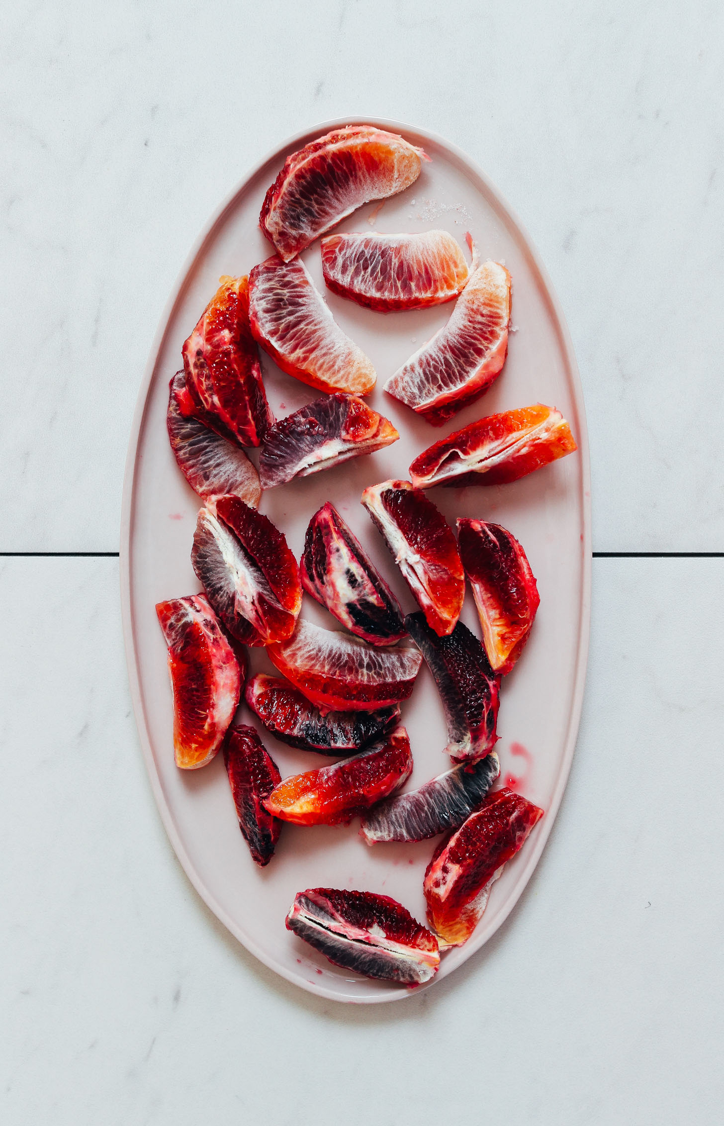 Platter of blood orange segments for freezing and making our Blood Orange Creamsicle Smoothie recipe