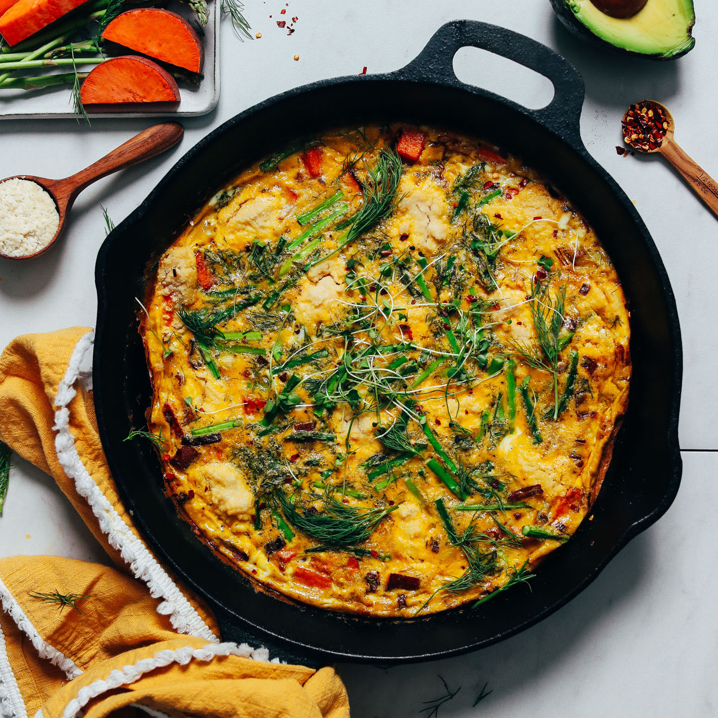 Cast iron skillet of Spring Vegetable Frittata made with asparagus