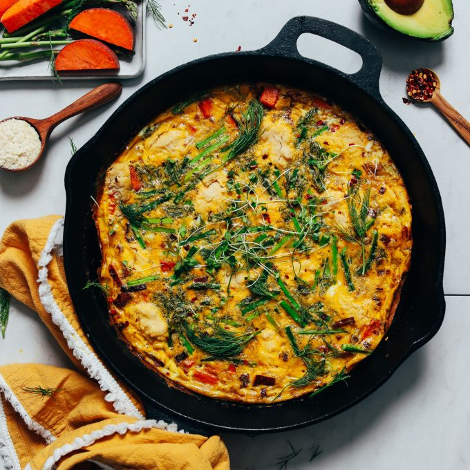 Cast iron skillet of our Spring Frittata made with Leeks, Asparagus, and Sweet Potato