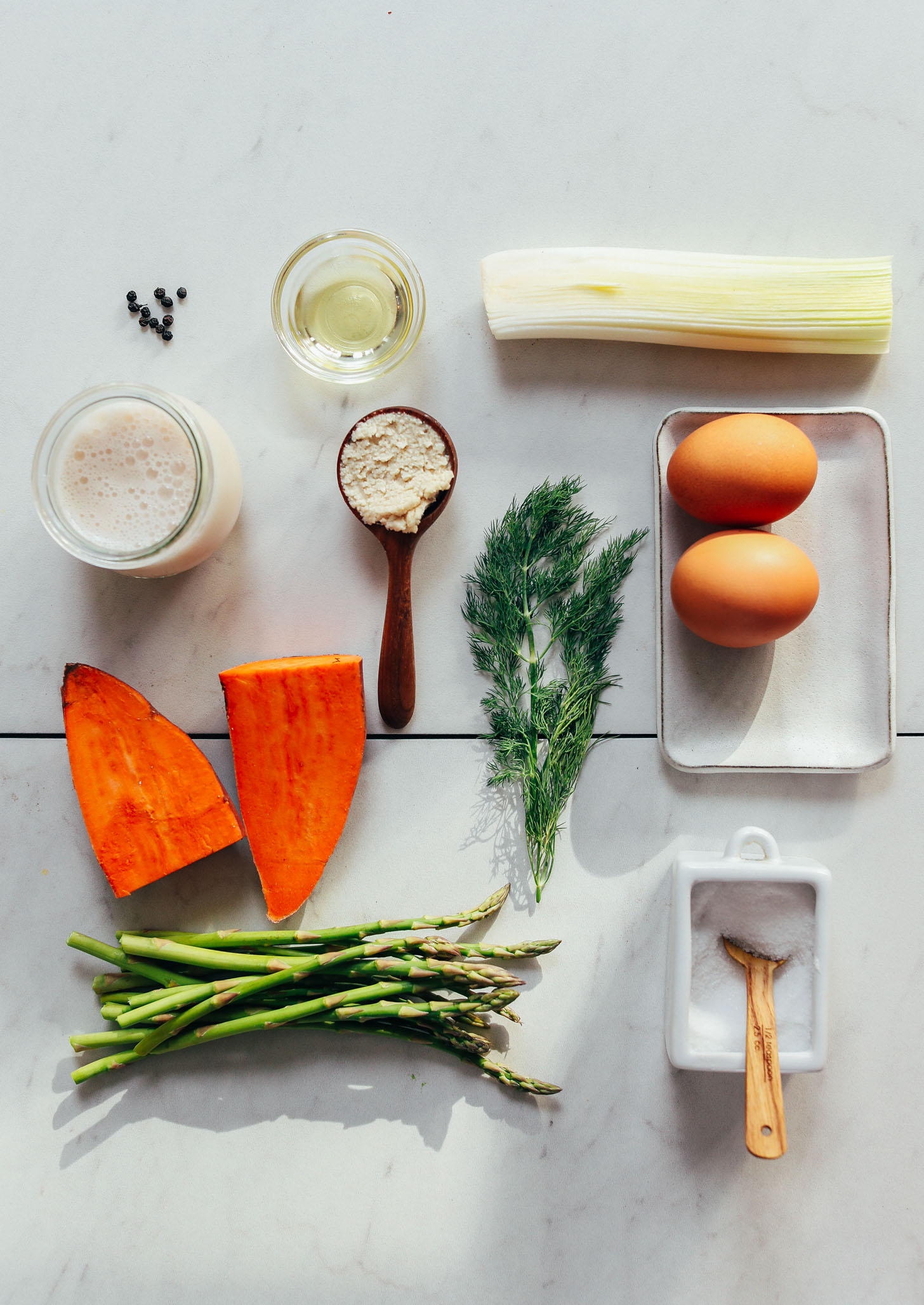Asparagus, sweet potato, leek, dill, eggs, and other ingredients for making our Spring Frittata recipe