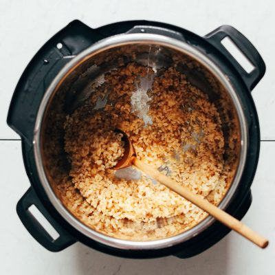 Instant pot filled with brown rice and water