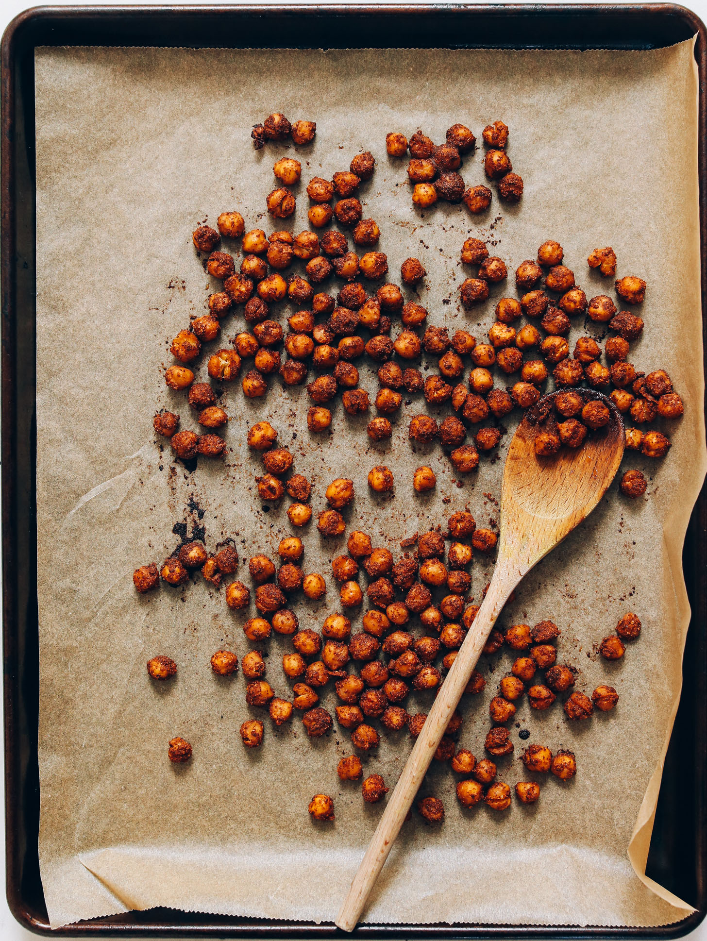 Parchment-lined baking sheet filled with Tandoori-Spiced Chickpeas