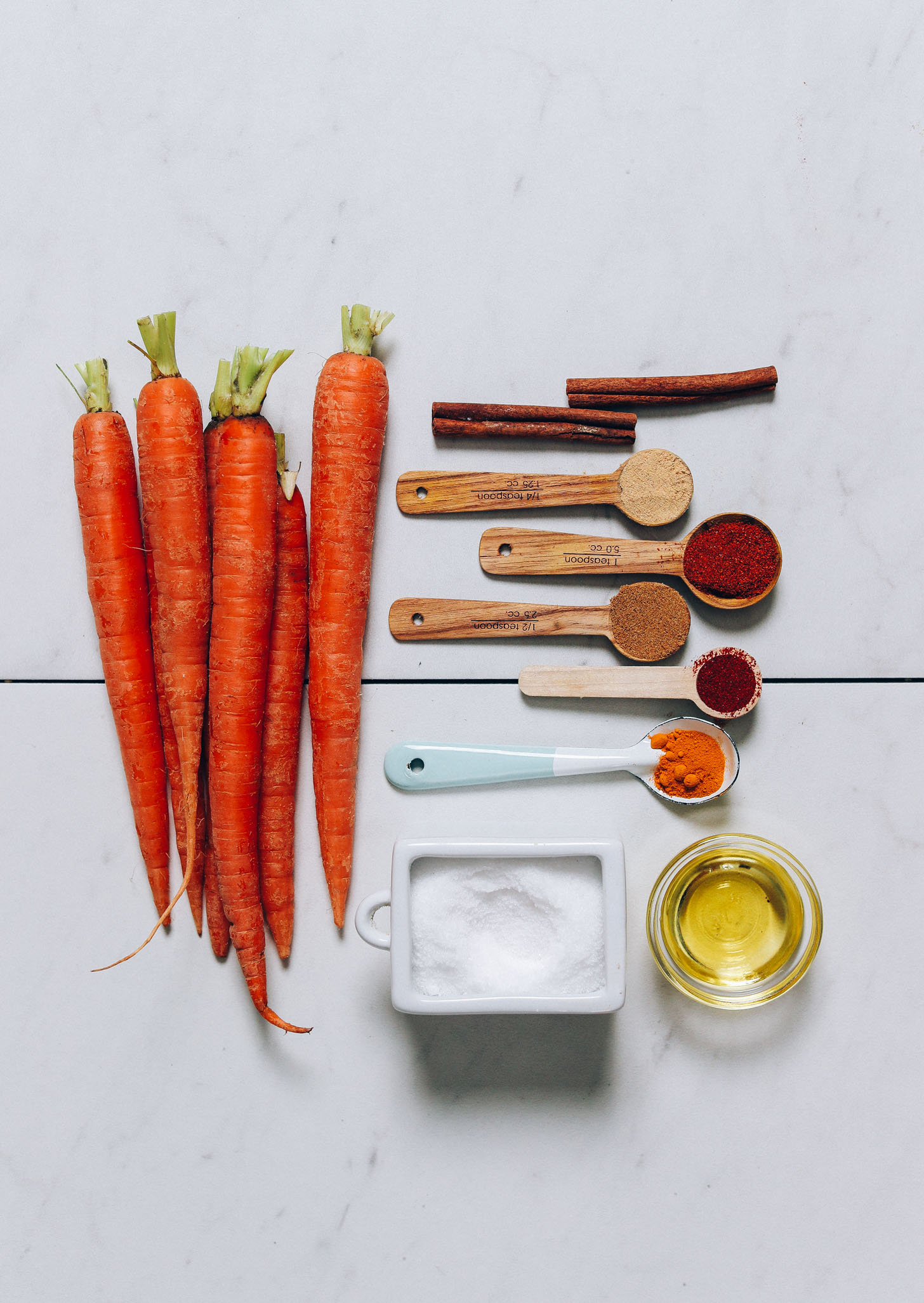 Carrots, cinnamon, ginger, smoked paprika, cumin, turmeric, salt, cayenne,  and avocado oil for making our Roasted Carrots recipe