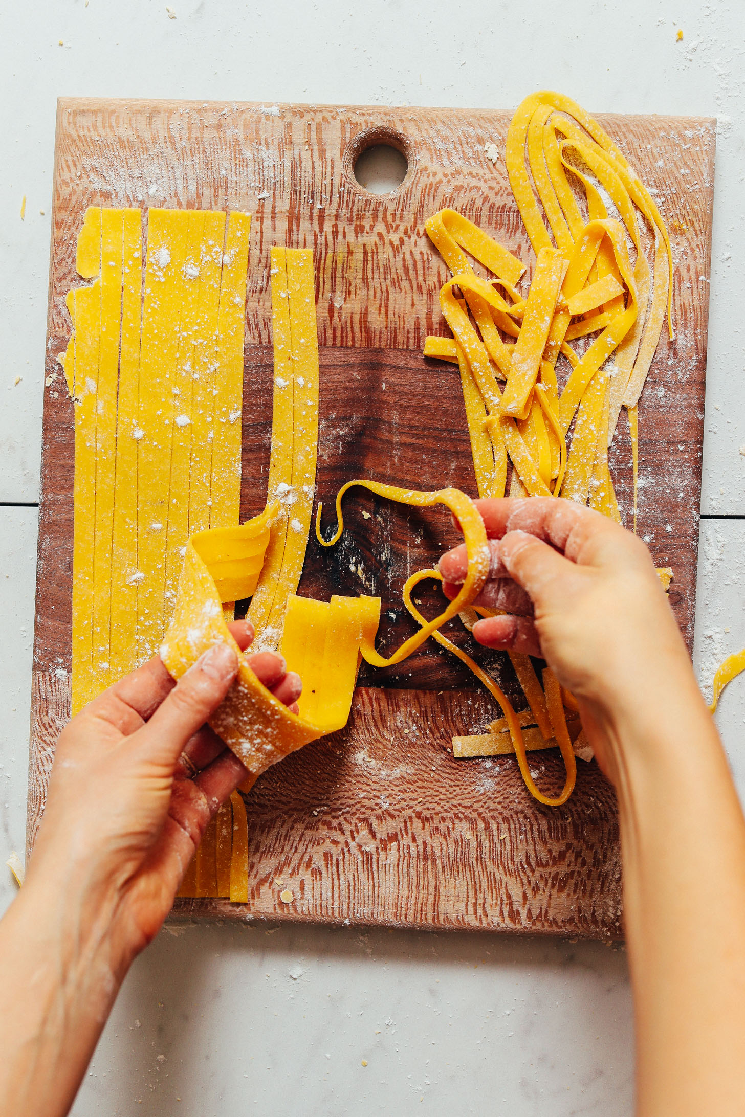 Picking up strips of our homemade Gluten Free Pasta recipe