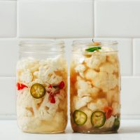 Two jars of Escabeche made with jalapeño and habanero