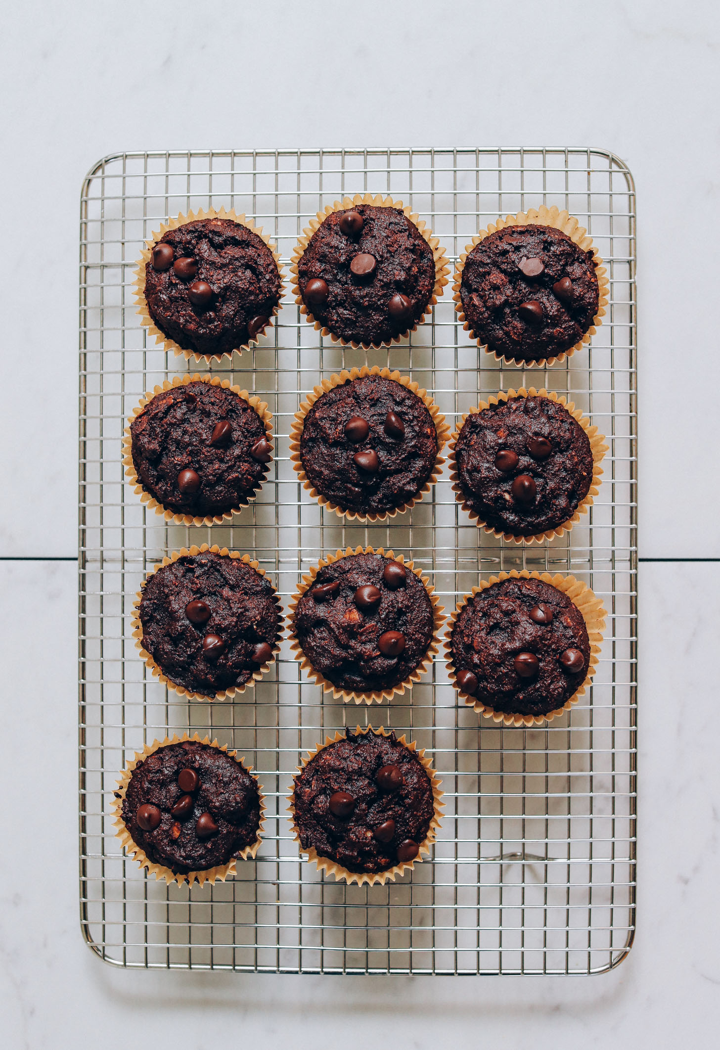 Cooling rack with a batch of our Fudgy Banana Chocolate Muffins recipe