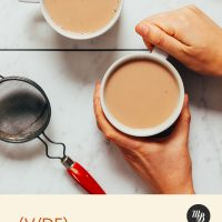 Holding the handle of a mug of our Easy Masala Chai Tea