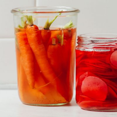Jar of Quick Pickled Carrots and part of a jar of Quick Pickled Radish