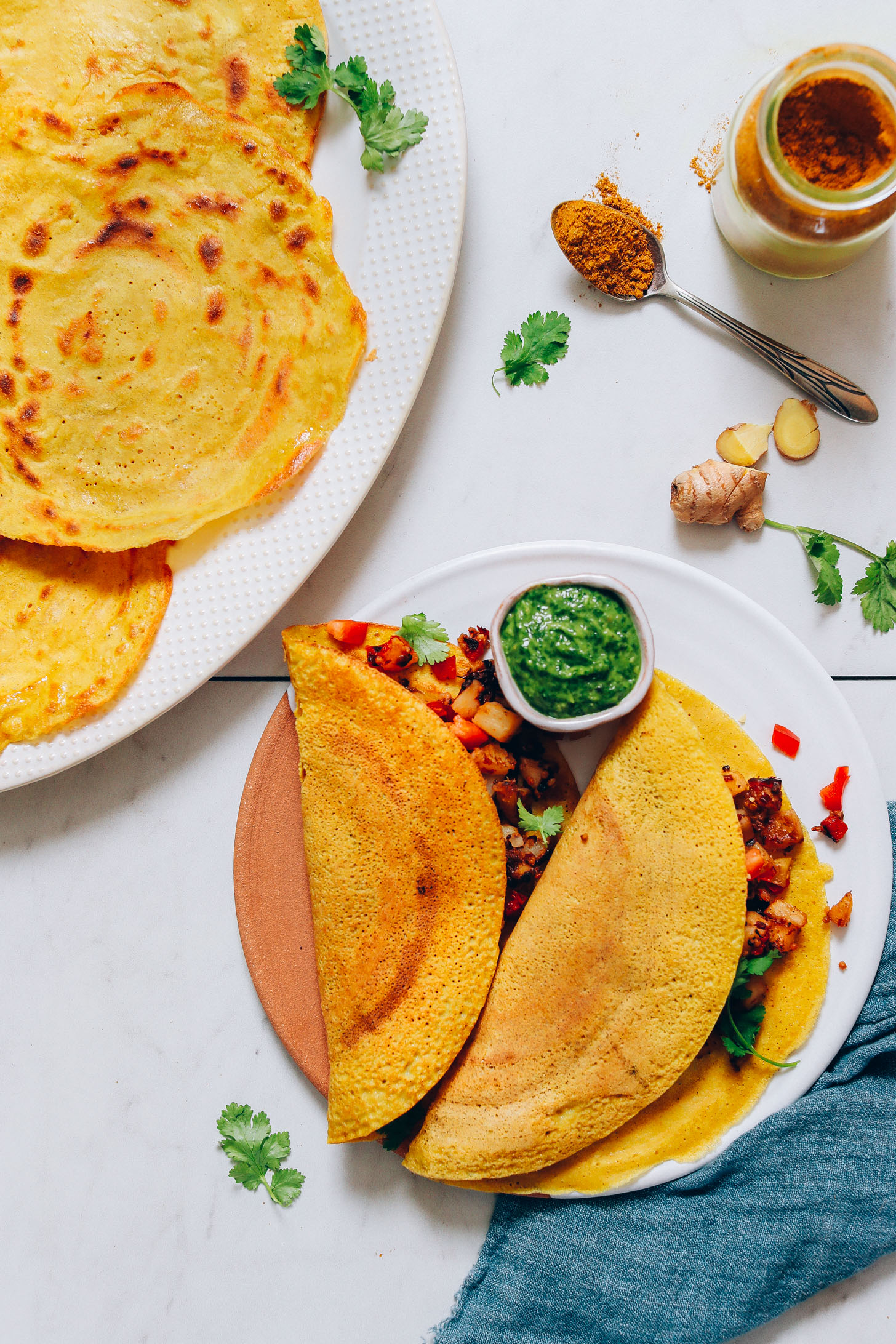 Platter and plate of moong dal dosas