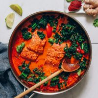 Large pot of Salmon Red Curry made with kale and red bell pepper