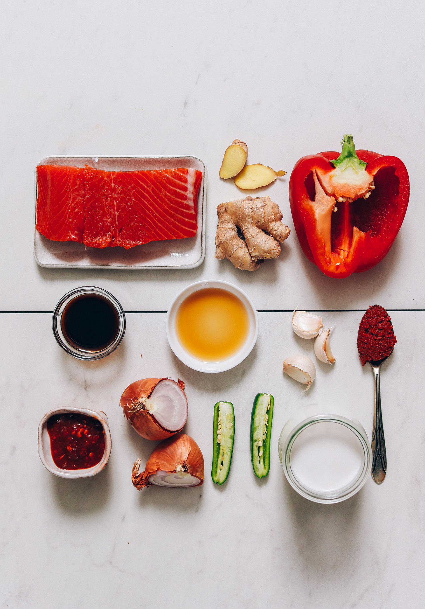 Salmon, ginger, red bell pepper, and other ingredients for making our Salmon Red Curry recipe