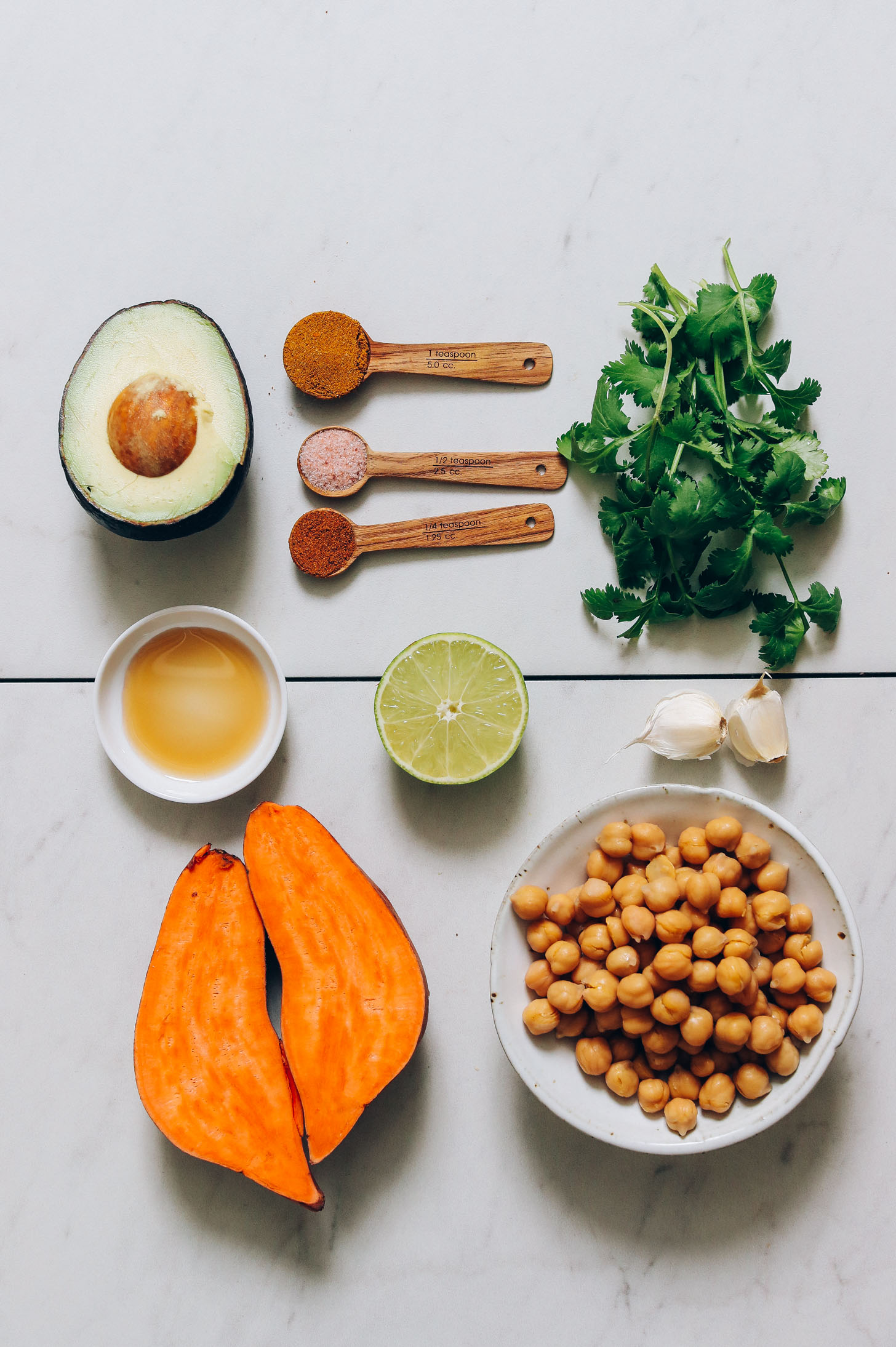 Avocado, dried spices, maple syrup, cilantro, garlic, chickpeas, and sweet potatoes