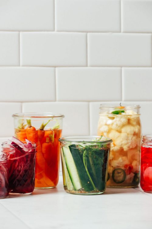 Jars of Quick Pickled Vegetables including, cucumbers, carrots, radishes, cauliflower, and onions
