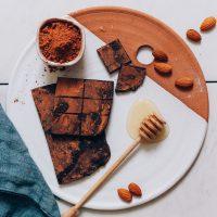 Honey, cacao powder, almonds, and homemade Honey Mama's Bars