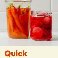 pickled carrots in a mason jar with recipe title