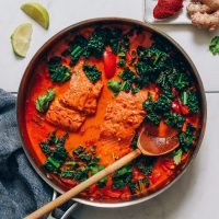 Skillet of Salmon Red Curry made with kale and coconut milk