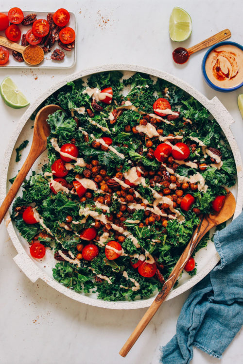 Large platter of our Chickpea Chopped Kale Salad drizzled with Chipotle Dressing