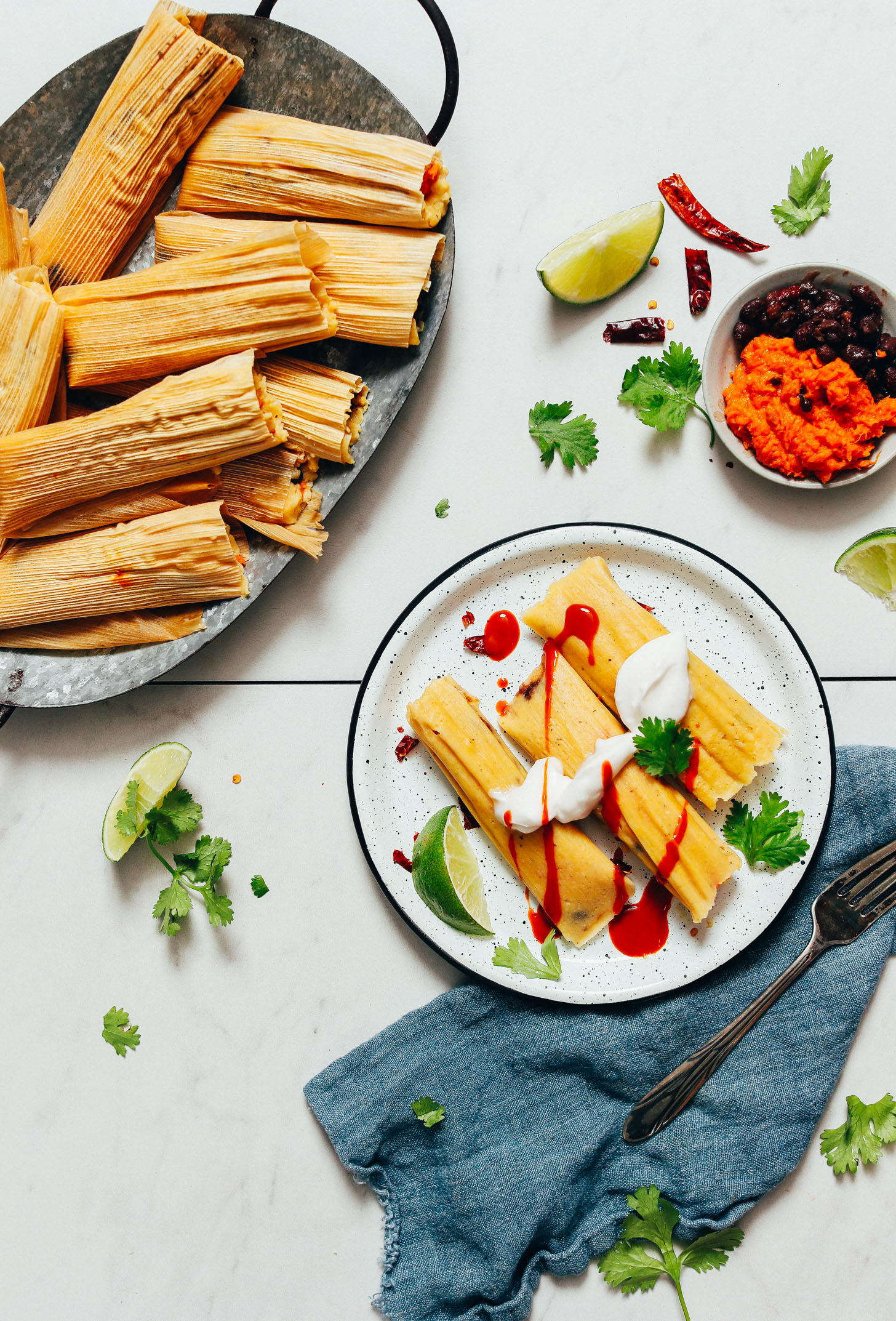 Tray and plate of sweet potato black bean tamales