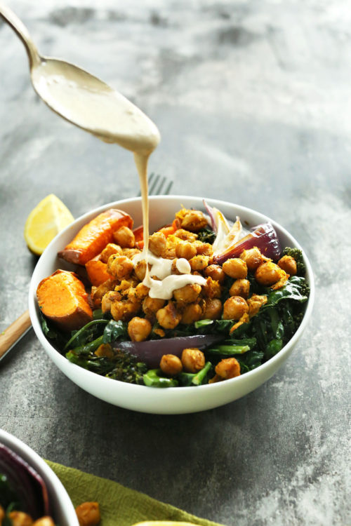 Drizzling tahini sauce over a Sweet Potato Chickpea Buddha Bowl