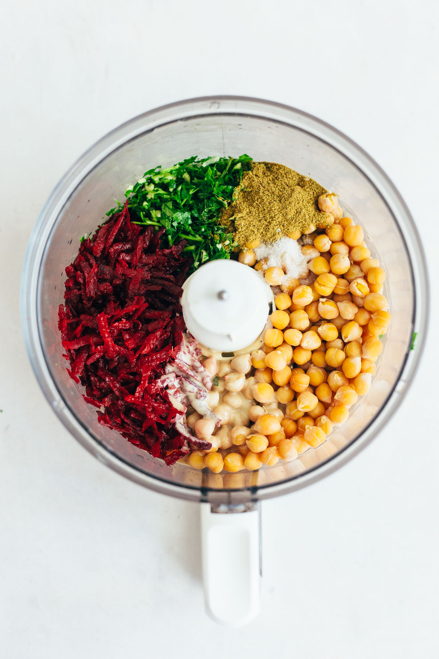 Blender with beets, parsley, cumin, salt, chickpeas, and tahini