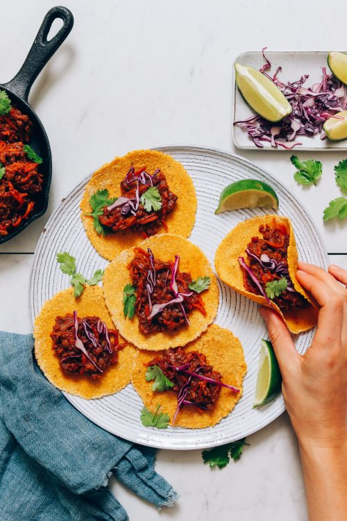 Plate of corn tortillas filled with Vegan Taco Meat