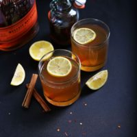 Two glasses of our Chili Cinnamon Hot Toddy recipe topped with lemon slices