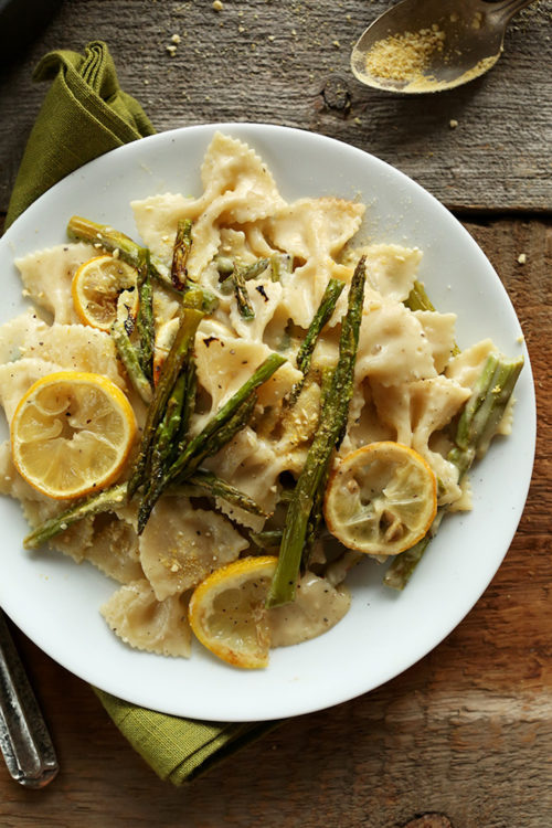 Plate of Creamy Vegan Lemon Asparagus Pasta on a wood background