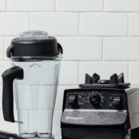 Vitamix 5200 blender in front of a tile background