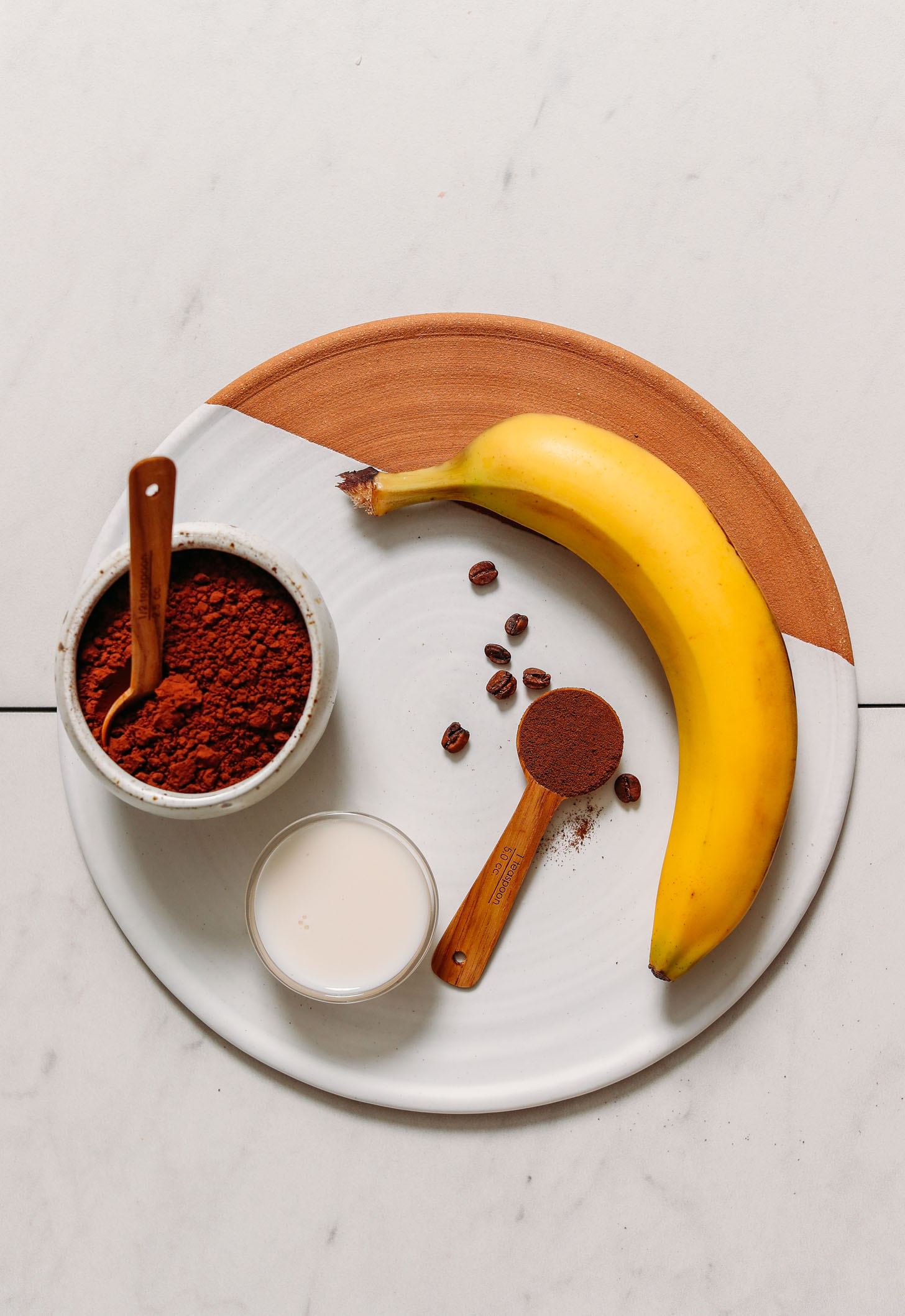 Tray with banana, coffee beans, dandy blend, cacao powder, and dairy-free milk