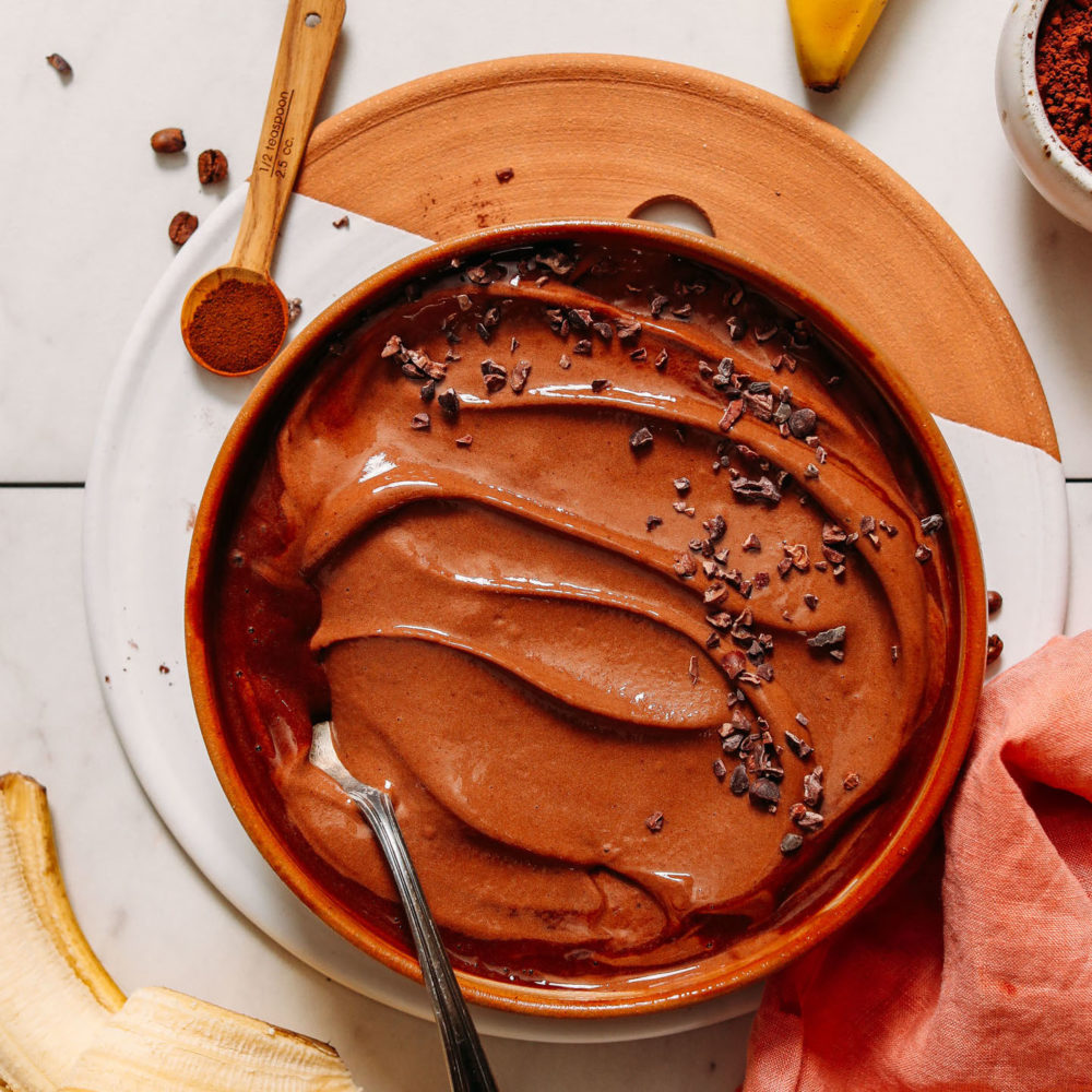 Vintage spoon in a wood bowl of Coffee Chocolate Banana Ice Cream