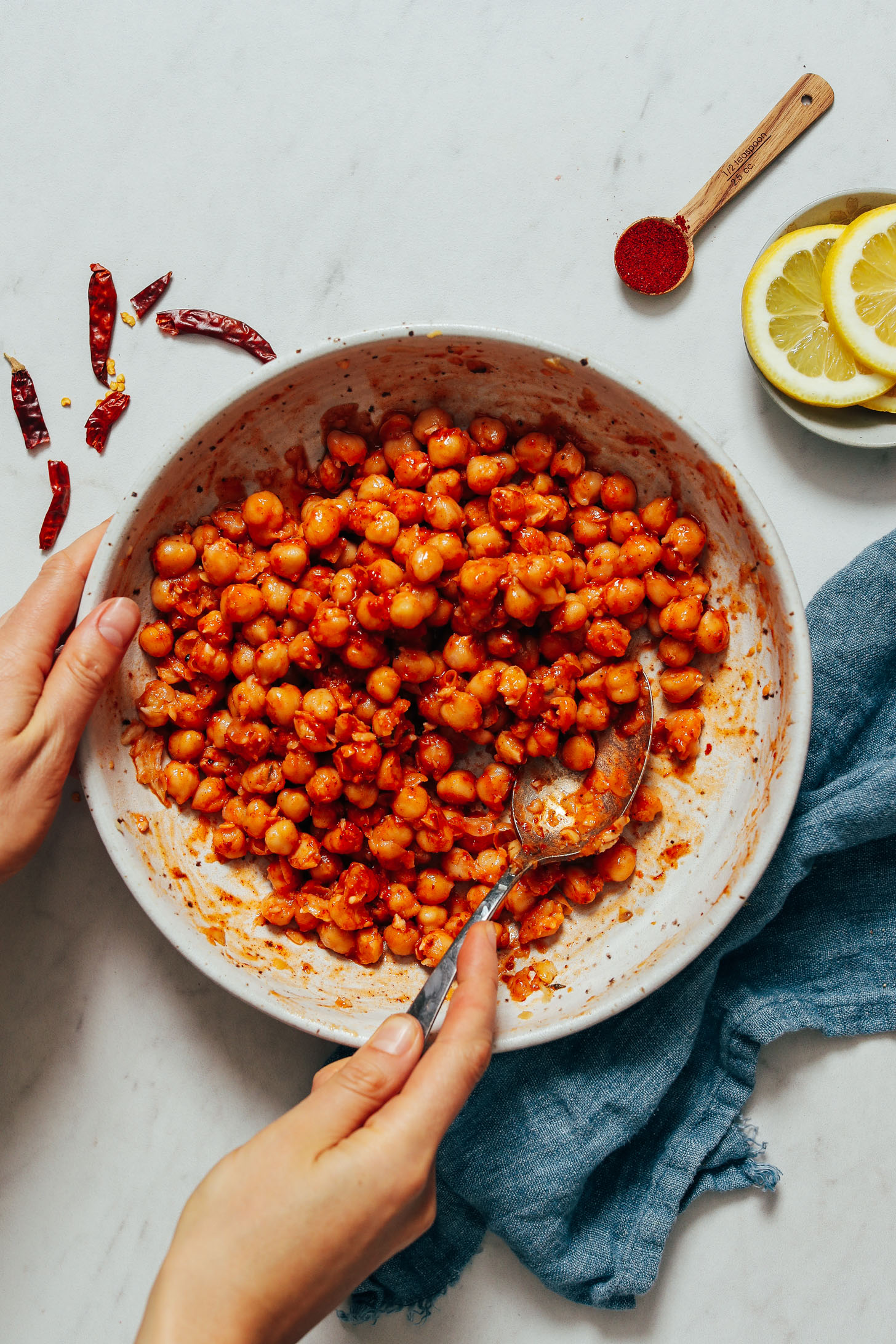 Holding a spoon and bowl of harissa chickpeas
