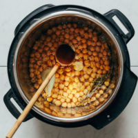 Instant Pot Chickpeas with a wooden spoon