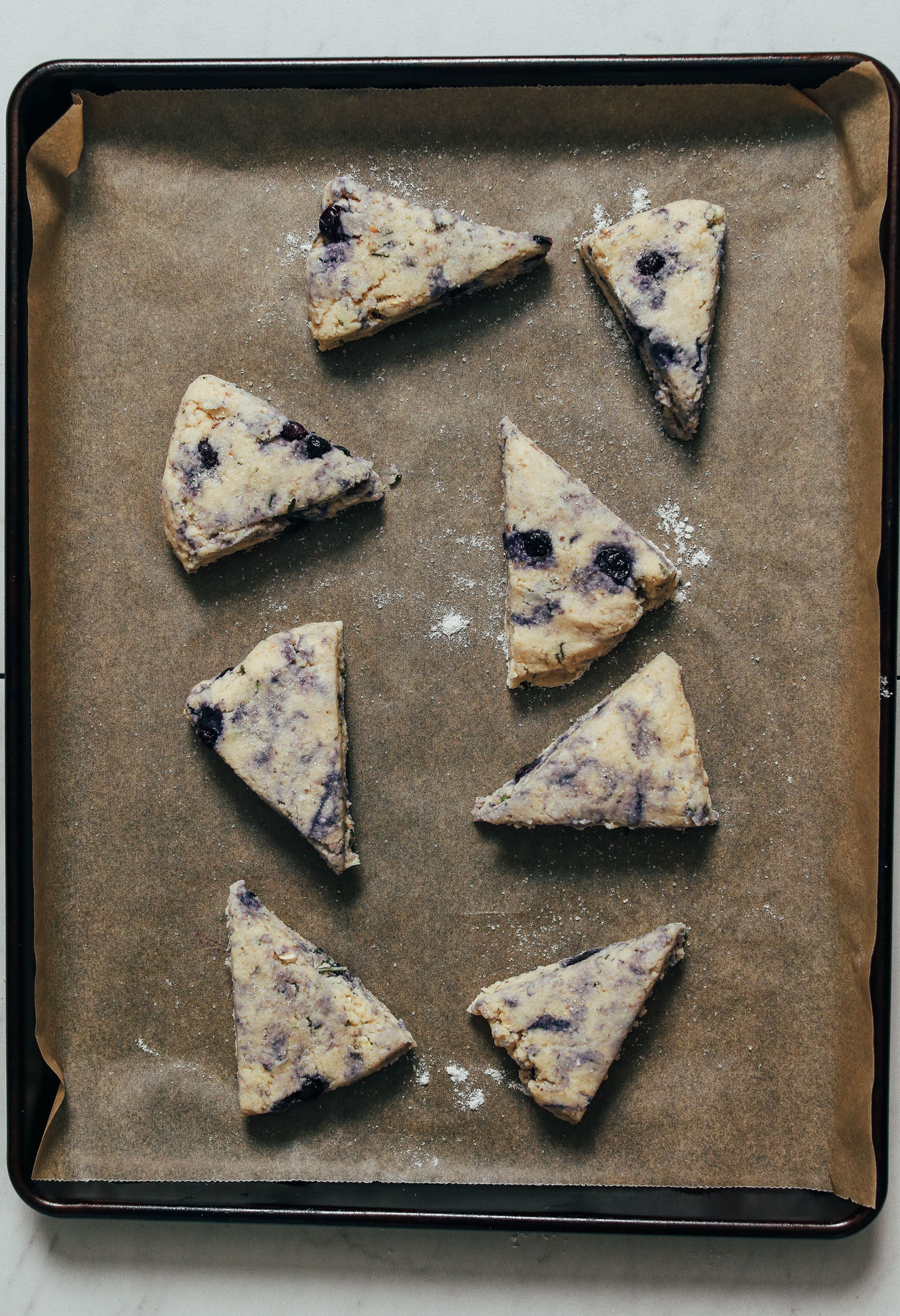 Baking sheet of unbaked Blueberry Scones ready to go in the oven