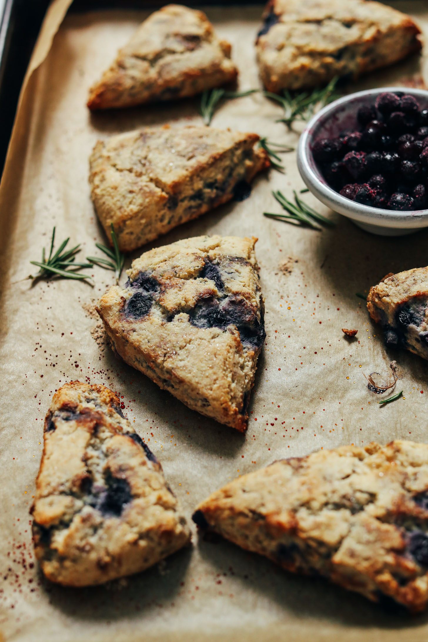 Parchment-lined baking sheet of flaky Gluten Free Scones