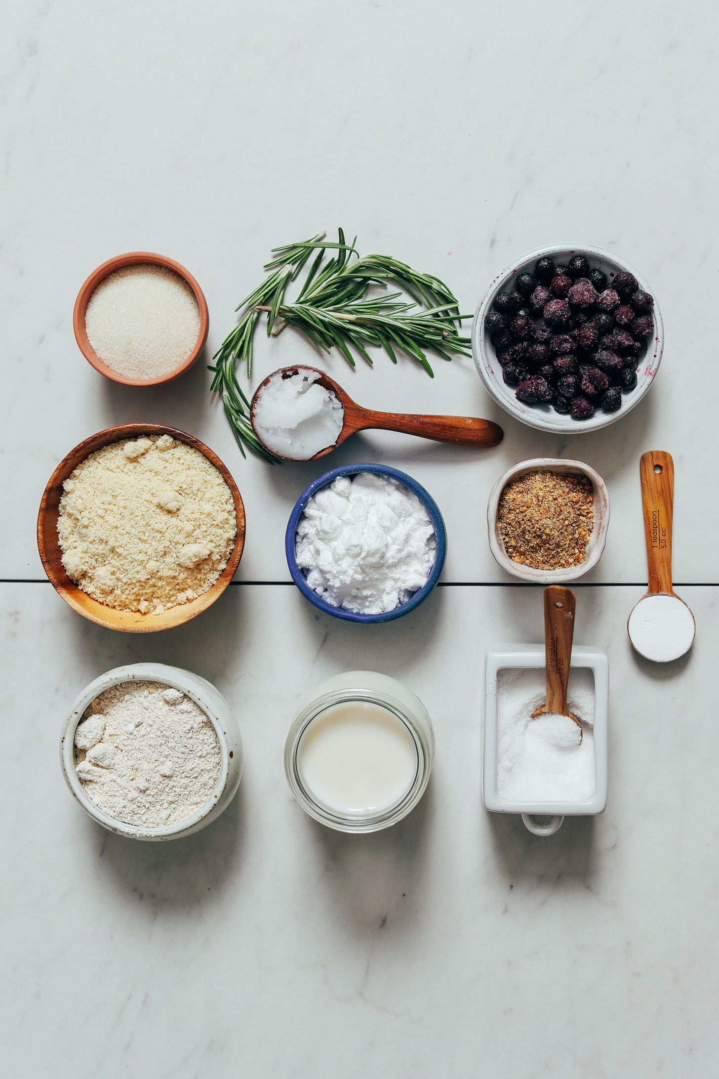 Dairy-free milk, gluten-free flours, coconut oil, flax, salt, rosemary, and wild blueberries