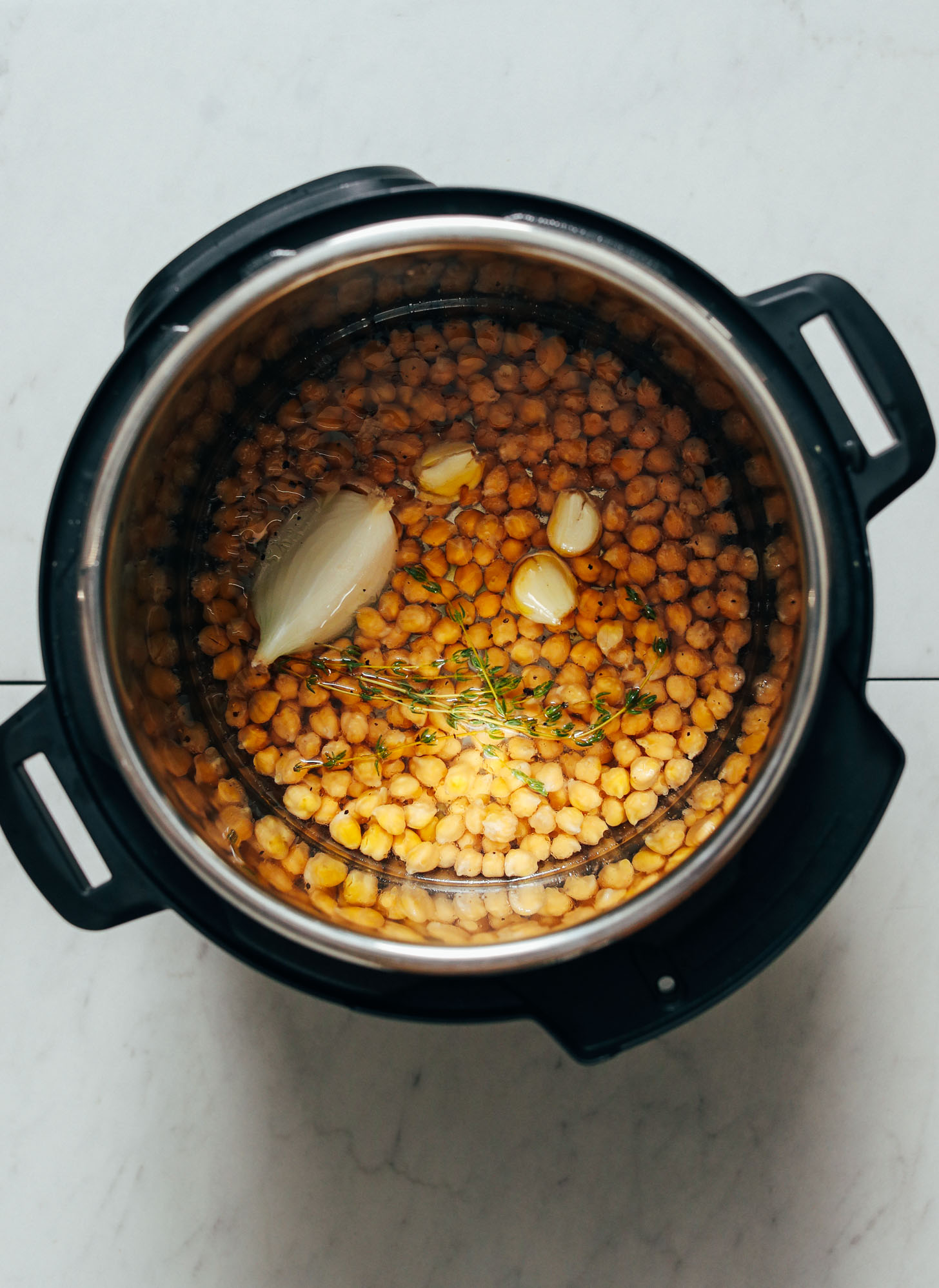 Instant pot with chickpeas, onion, garlic, and thyme