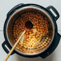 Wooden spoon in an Instant Pot for making chickpeas