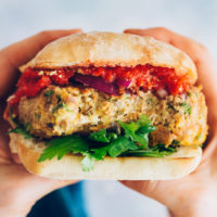 Close up shot of a Vegan Pizza Burger on a ciabatta bun with parsley and marinara
